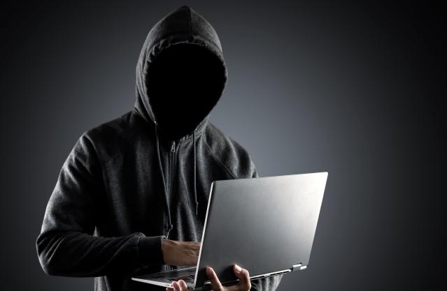 Cybercrime,,Hacking,And,Technology,Crime.,No,Face,Hacker,With,Laptop
