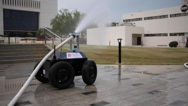 QU female engineers invent firefighting robot.jpg