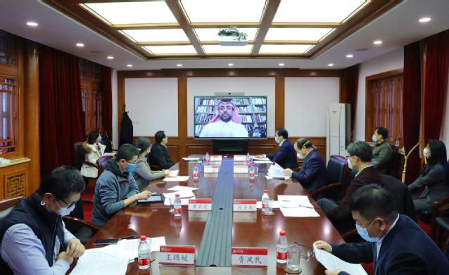 Dr. Hassan Rashid Al-Derham, President of QU during video conference held at PKU.jpg