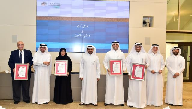 group photo of QU officials at ceremony of marking the ISO accreditation for its units