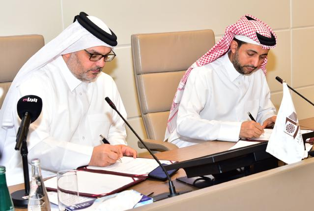 Dr Hassan Al Derham and H.E. Dr Eng Saad bin Ahmad Al Muhannadi signing the MoU