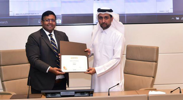 Dr. Hassan Al Derham receiving the ranking certificate from Ashwin Fernandes