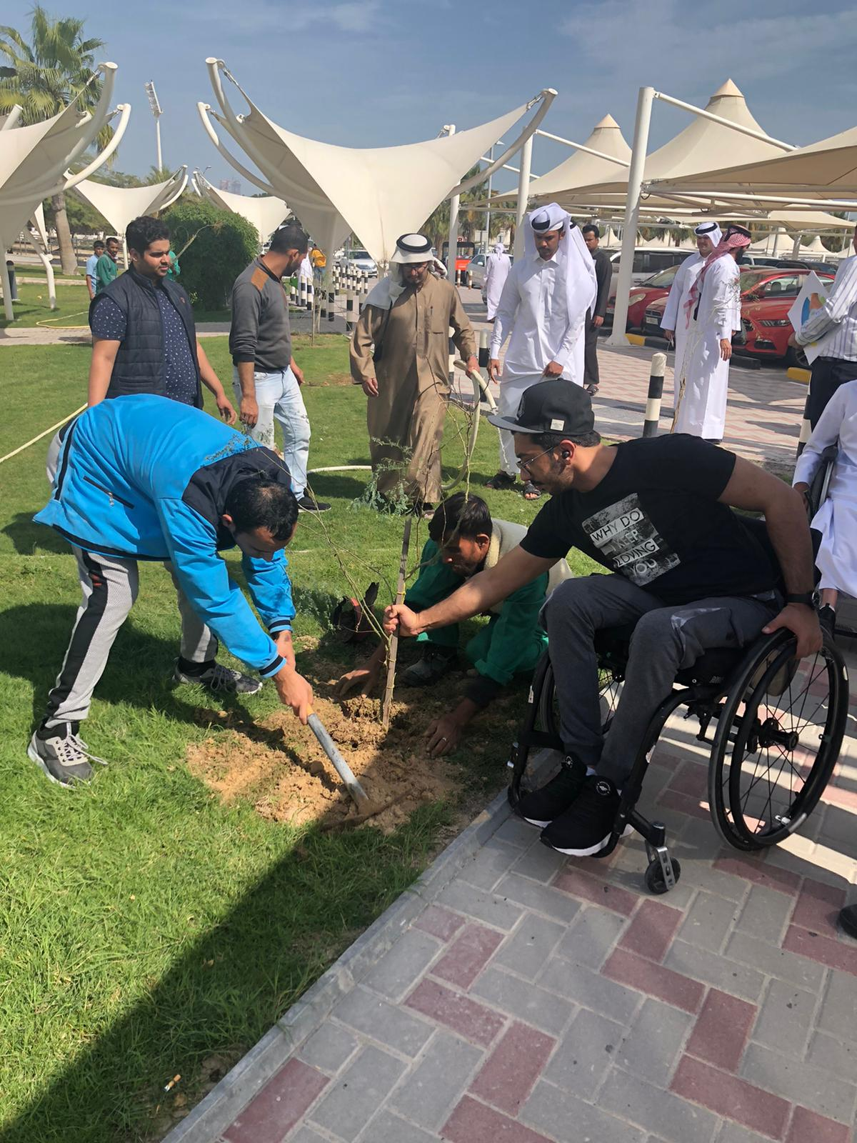 Photo of special needs students planting